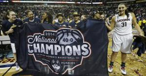 Stefanie Dolson (31) and The Connecticut women's team holds up their championship banner after crushing Notre Dame in battle of undefeated teams, a day after UConn men's team celebrated their championship