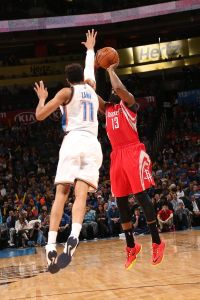 OKLAHOMA CITY, OK - NOVEMBER 16: James Harden #13 of the Houston Rockets takes a shot against the Oklahoma City Thunder on November 16, 2014 in Oklahoma City, Oklahoma.