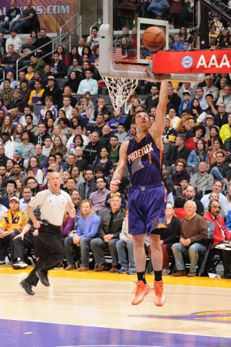 LOS ANGELES, CA - DECEMBER 28: Goran Dragic #1 of the Phoenix Suns goes to the basket against the Los Angeles Lakers on December 28, 2014 at Staples Center in Los Angeles, California.