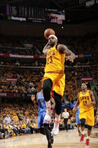 CLEVELAND, OH - JANUARY 25: LeBron James #23 of the Cleveland Cavaliers goes up for a dunk against the Oklahoma City Thunder during the game on January 25, 2015 at Quicken Loans Arena in Cleveland, Ohio.